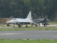 One JF-17 in front of two parked Mirage 5 cropped version-1-