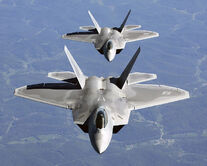 750px-Two F-22A Raptor in column flight - (Noise reduced)