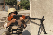 Iraqi soldier with RPK