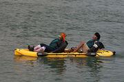 Two Interesting Ladies Lean Back in a Dual Kayak
