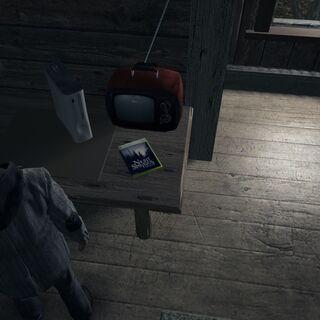 Pokój Emersona z telewizorem, konsolą Xbox 360 i grą <a class=