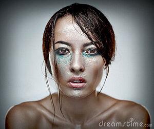 Beauty-head-shot-woman-heavu-makeup-20816484