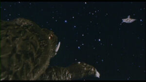 Gamera charges towards his final destiny with the Zanon ship.