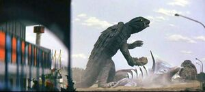 Gamera plays his theme tune on Zigra's spines.
