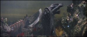 Gamera and Guiron fight.