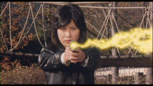 Giruge fires her laser gun.