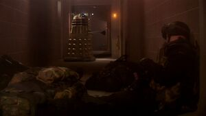 The Dalek kills the guards