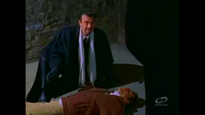 Suudor over Cole's weakened body.