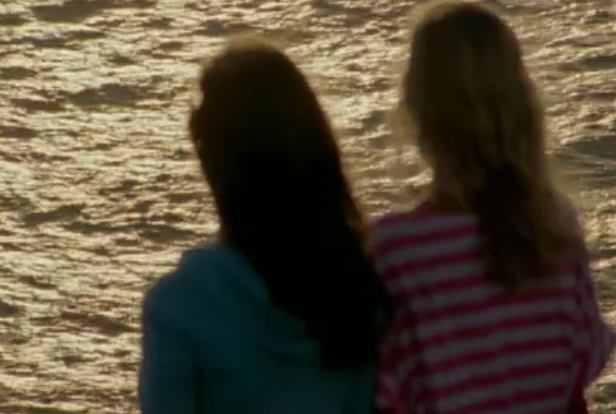 File:Zoey and Kiki looking at the ocean.png