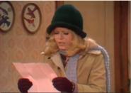 AITF 2x8 - Gloria retrieves realty leafelt left on door