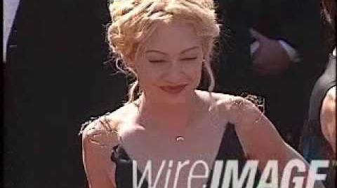Portia de rossi arriving at emmy awards 1999
