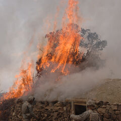 US troops burn a suspected Taliban safe near Kandahar in 2022.