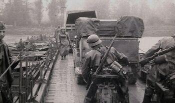 German vehicles crossing pontoon bridge over the Berounka River (WFAC)