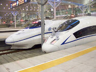 800px-CRH2 & CRH3 at Tianjin Railway Station