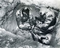 Two-Soviet-infantrymen-who-froze-to-death-in-their-fox-hole,-Finland,-1940