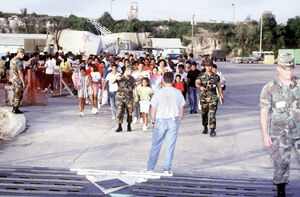 Army-escorting-cubans-to-flight-to-usa