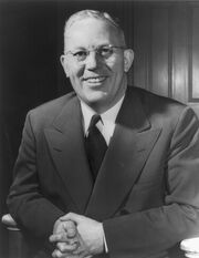 Earl Warren Portrait, half figure, seated, facing front, as Governor