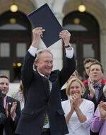Chafee-after-signing-ssm-bill