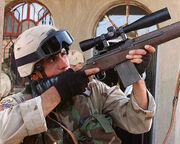 RNG sniper aiming at raider defenders