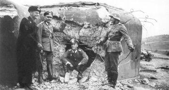 German soldiers near destroyed bunker in Plan 1938 (WFAC)