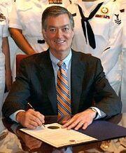 220px-Governor of Colorado Bill Owens 060502-N-5324D-001 crop