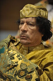 399px-Muammar al-Gaddafi at the AU summit-LR