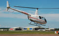 Heli Air Robinson R44 Raven II arrives RIAT Fairford 10thJuly2014 arp.jpg