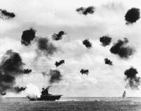 USS Yorktown (CV-5) is hit by a torpedo on 4 June 1942
