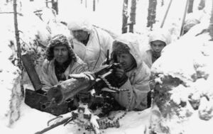 A group of soldiers in snowsuits manning a heavy machine gun
