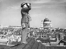 33 Aircraft spotter on a London rooftop