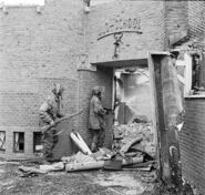629px-Dutch school being searched for German snipers