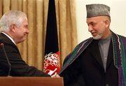 Gates with Karzai 2009