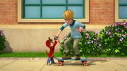 Alvin teaching The New Kid to skateboard