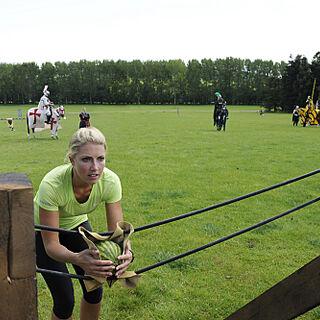 Rachel preparing to fire a shot in the first leg's roadblock.