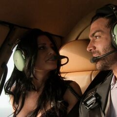 Matt &amp; Ashley riding in a helicopter during the <a href=