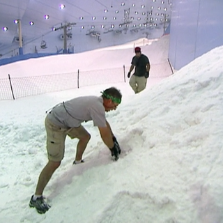 Gary & Matt search for a snowman at the <i>Find a Snowman</i> Detour in the <a href=