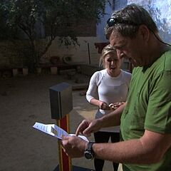 Gary & Mallory reading their Detour clue during the seventh leg.