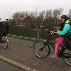 Jelani &amp; Jenny bicycling to their next <a href=