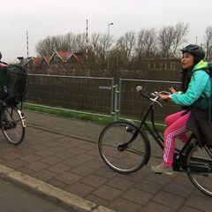 Jelani & Jenny bicycling to their next <a href=