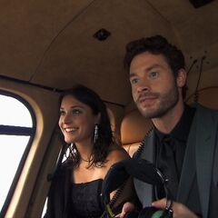 Aly &amp; Steve riding in a helicopter during the <a href=