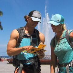 Adam & Bethany reading their detour clue in the <a href=