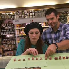 Brendon & Rachel doing the <i>Name That Salami</i> Detour in the <a href=