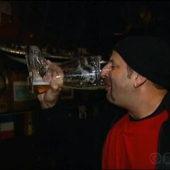 Louie drinking from a boot of beer in the fourth leg.