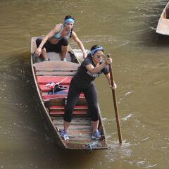 Kym & Alli punting a boat in Leg 2.