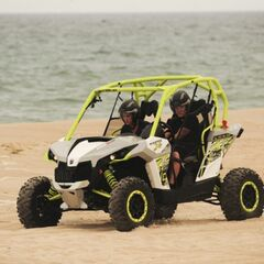 Kelsey & Joey riding dune buggies.
