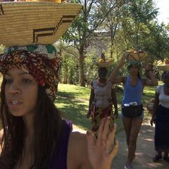 Jazmine &amp; Danielle carry fruit baskets on their heads to the <a href=
