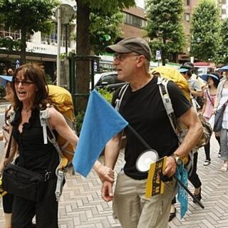 Marcy & Ron leading their group of tourists in the <a href=