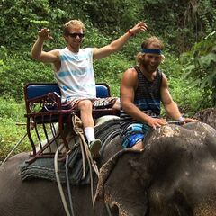 Andy & Tommy riding an elephant in the <a href=
