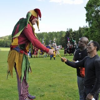 Ron & Tony receiving a clue from the court jester after completing <a href=