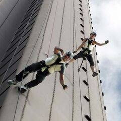 Rachel & Dave rappelling down the Makai Tower in the final leg.